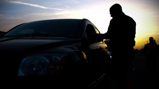 extreme DUI in Phoenix - silhouette of a man beside a car