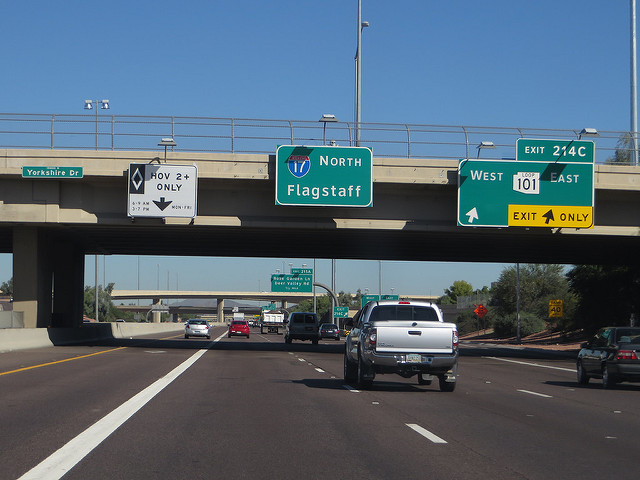 dui in phoenix - road signs on a bridge over the highway