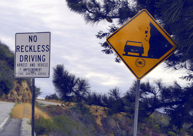 "reckless driving in arizona - road sign with ""No reckless driving"""