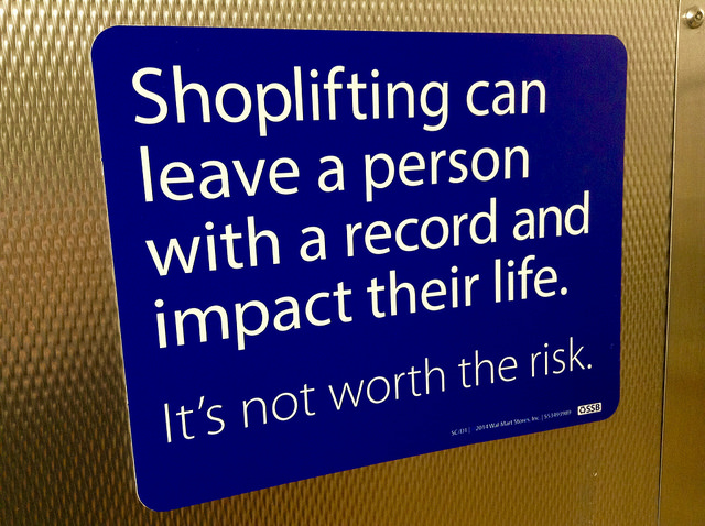 Shoplifting in Arizona - sign cautioning against shoplifting