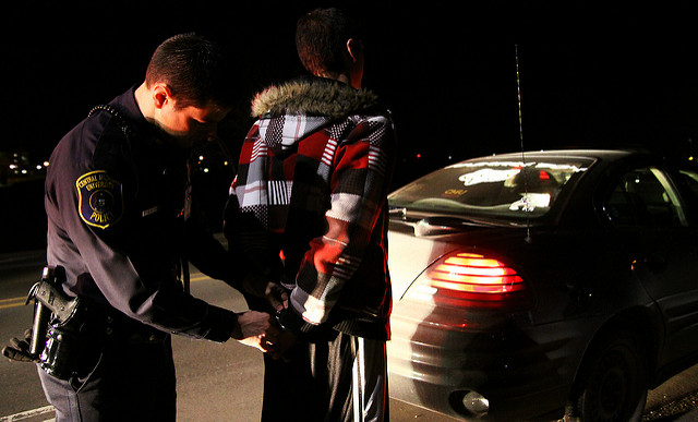 DUI in Chandler, Arizona - officer handcuffing a person