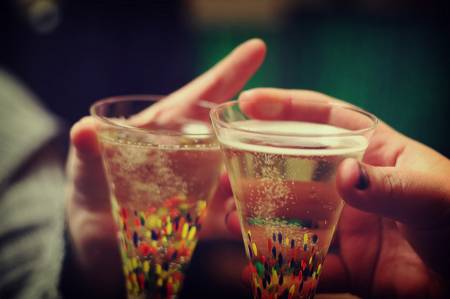 two conical champagne glasses filled with drink