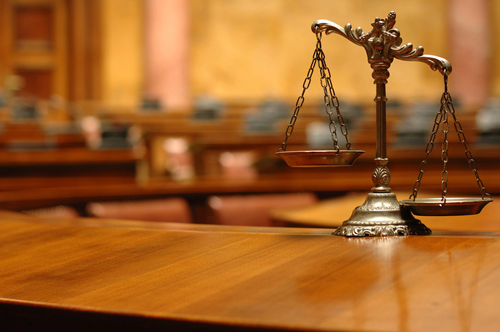 sentencing, law - balancing scales in the empty courtroom