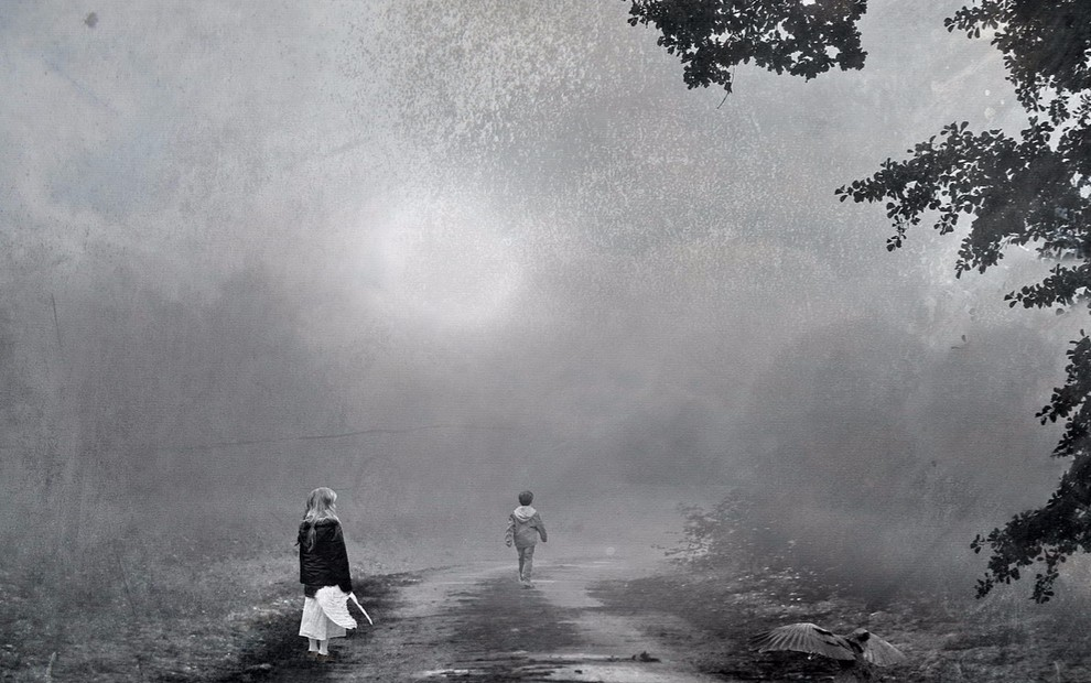 felony child porn blog - backs of two children standing on a road on a foggy evening