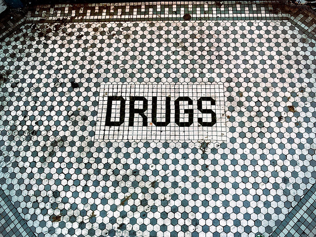 Felony drugs blog - DRUGS written on tiles with a patterned background