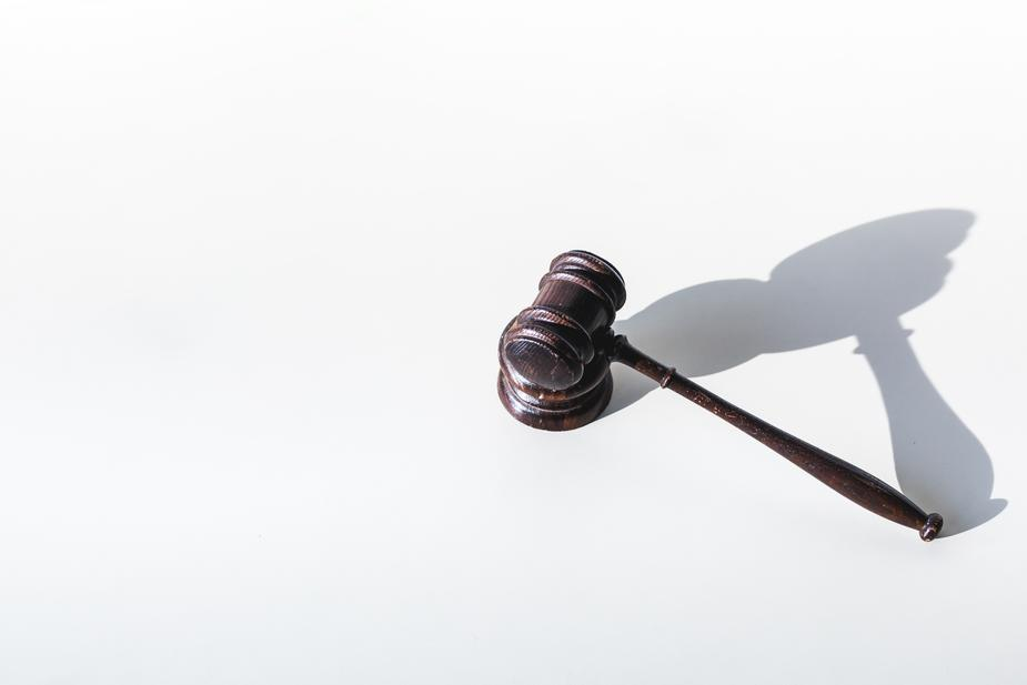criminal defense attorney in Arizona - gavel and its shadow
