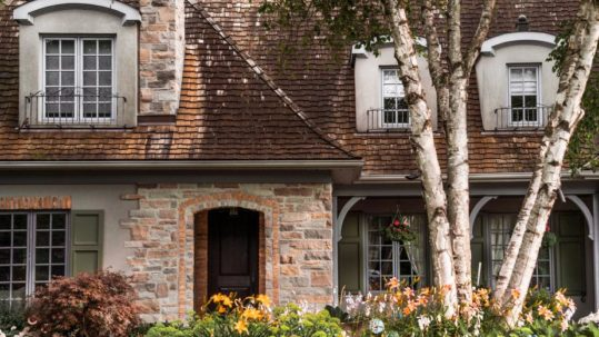 Todd Coolidge Law Firm in Chandler, AZ - front view of a stone house with a tiled roof