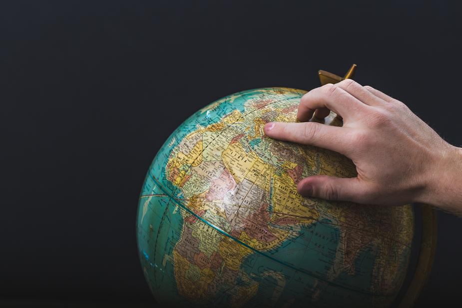 DUI conviction - Hand placed on a globe