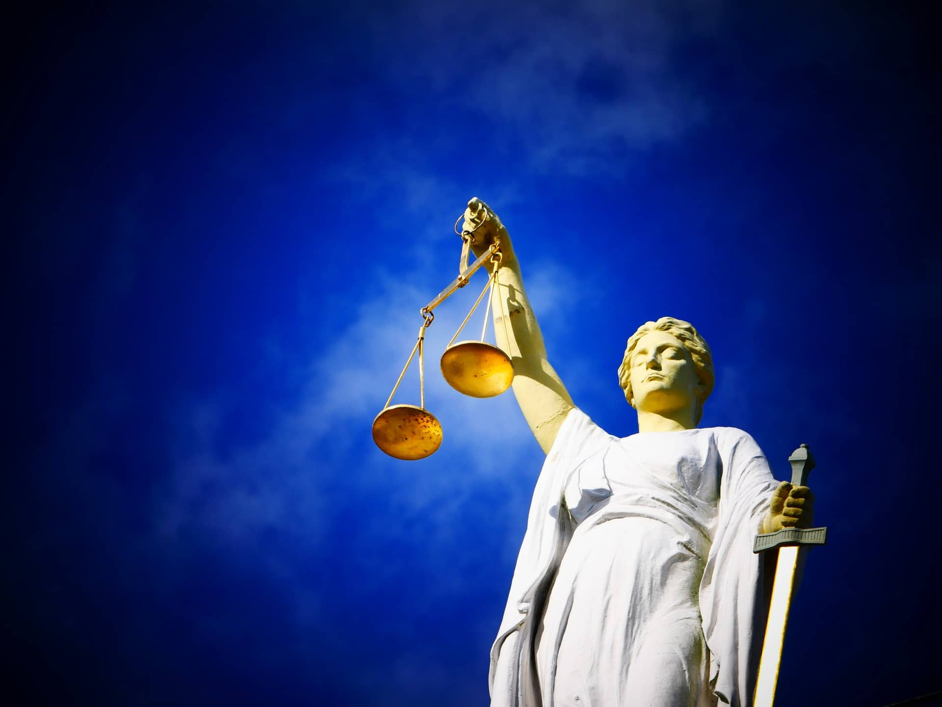 criminal offense in arizona - statue of lady justice holding scales and a sword