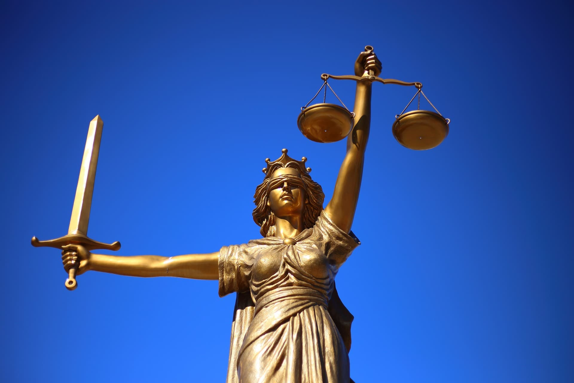 lawyer withdraw from representation - lady justice with scales and sword